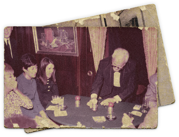 Photograph of legendary magician Dai Vernon performing in The Close-Up Gallery of The Magic Castle.